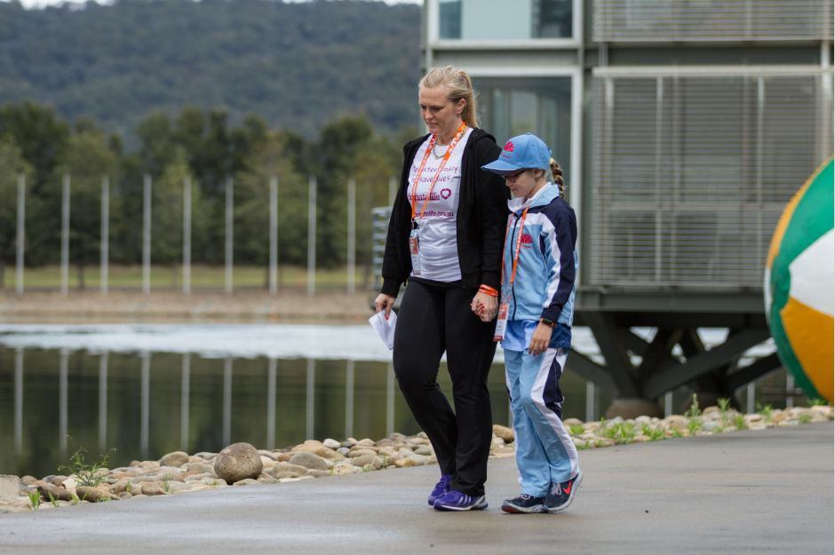 Mother and daughter: Katelan and Kyla approach the stage at the Opening Ceremony of the Transplant Games to address audience and media