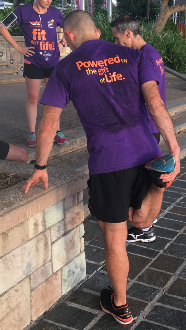 Winner of the Fit for Life Fun Run, Andrew, warms down after the race
