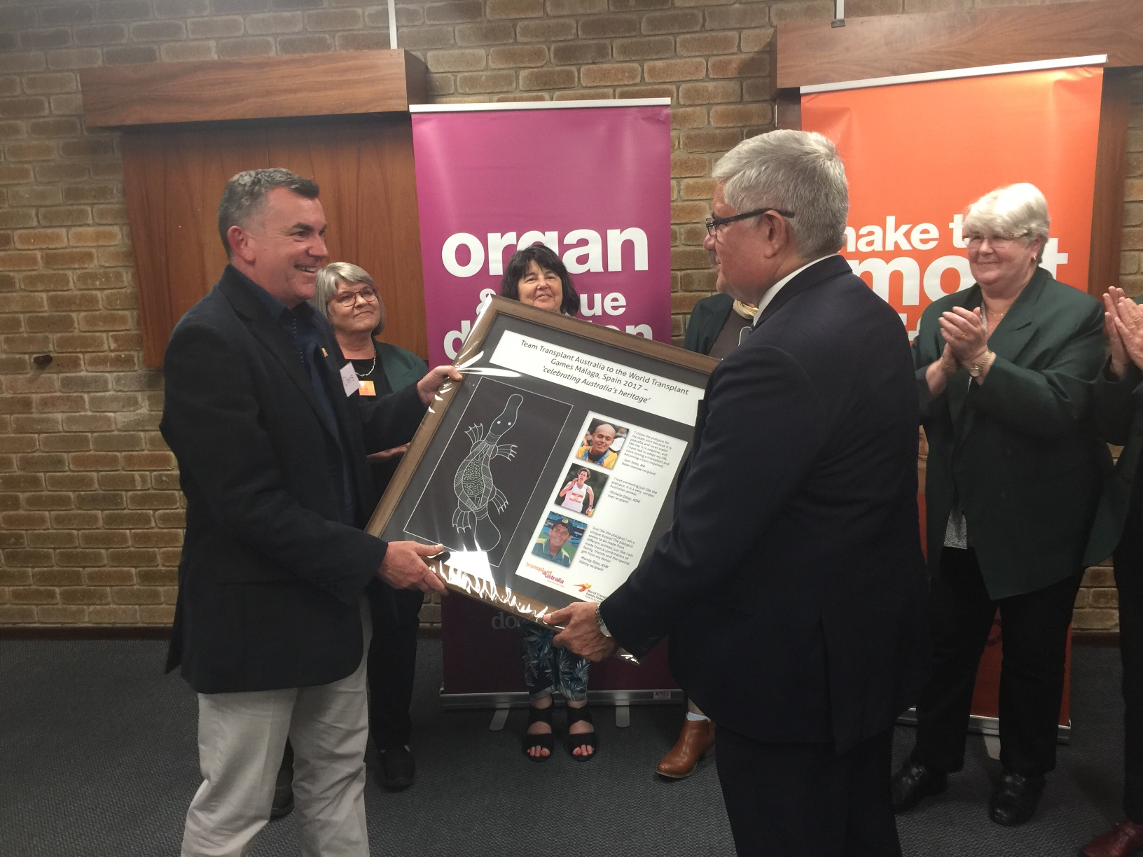 Transplant Australia CEO Chris Thomas presenting Minister Wyatt with an artwork